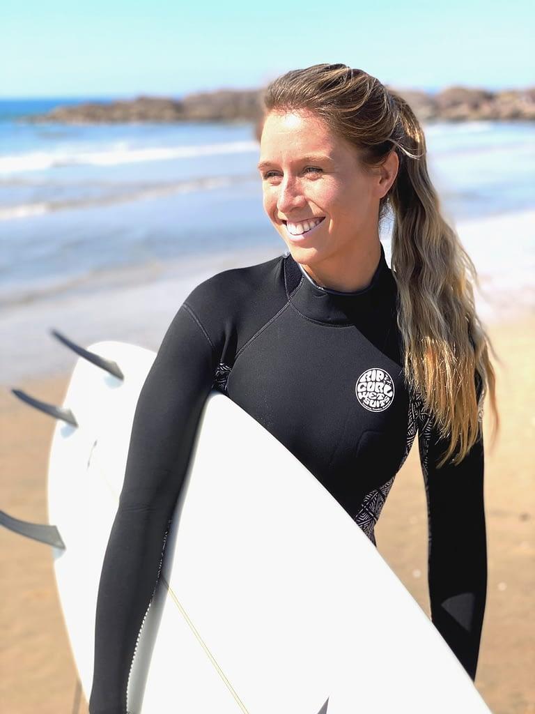 Kimberly holding surfboard